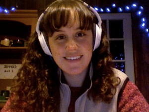 2015 Author Ashley Crookham writing with white headphones